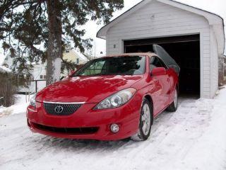 2005 Red Toyota Camry Solara Convertible 3.  3l V6 photo