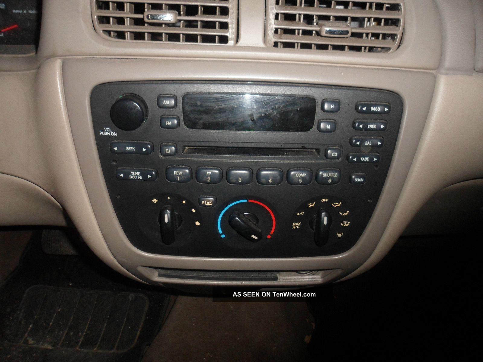 ford taurus se comfort sedan  door