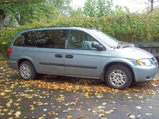 2005 Gray Dodge Grand Caravan With Wheel Chair Assist. photo