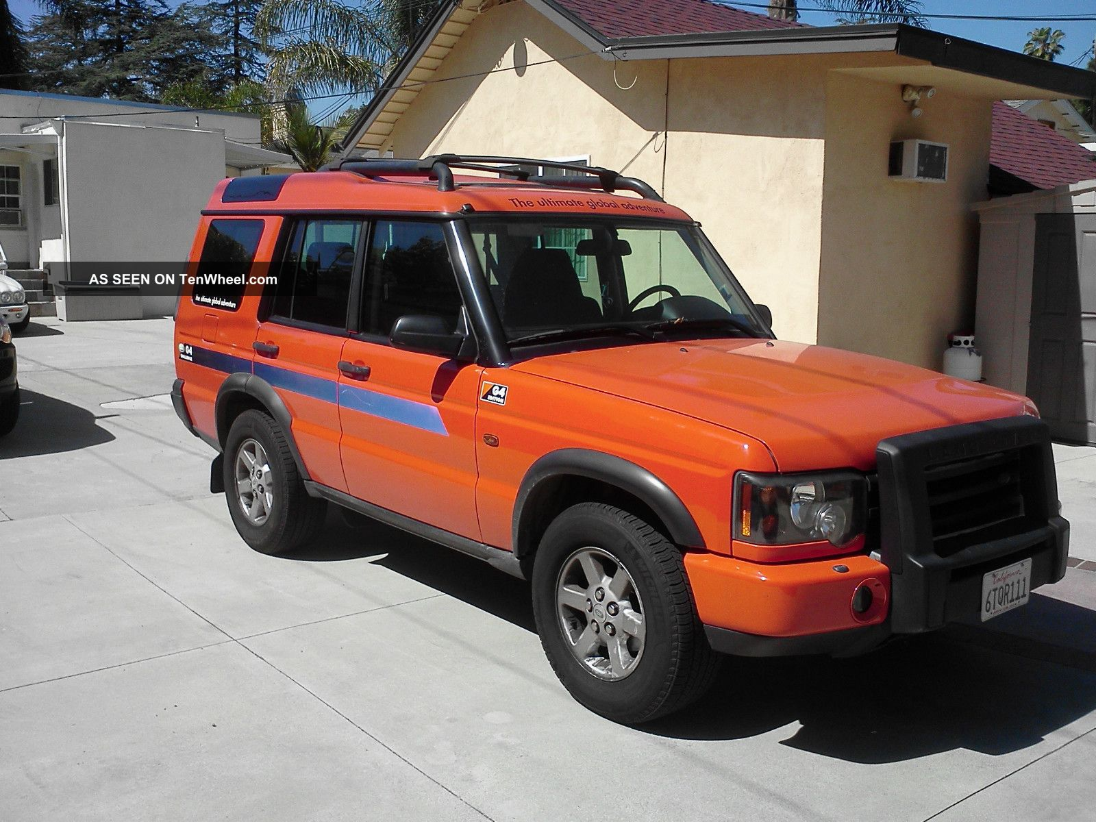 2004 Orange Land Rover Discovery G4 Lmited Edition