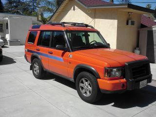 2004 Orange Land Rover Discovery G4 Lmited Edition photo