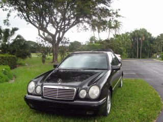 1998 Blac Merceds Benz E 430 photo