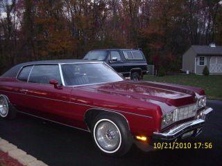 1973 Chevy Impala Custom. .  Burgundy With Black Vinyl Roof. photo