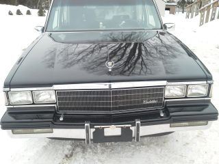 1986 Black Cadillac Fleetwood Hearse photo