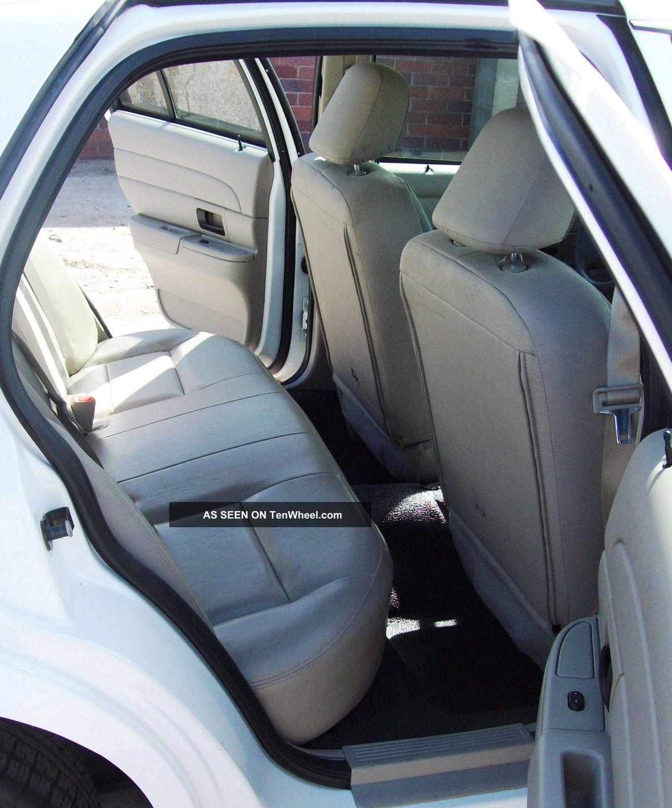 2012 Maserati Quattroporte Interior: White 2008 Ford Crown Victoria