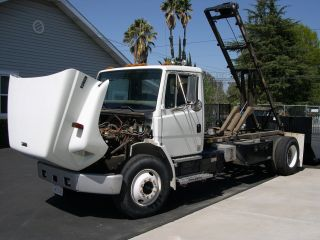 2002 Freightliner Fl70 Truck With Flat And Dumpster Switch N Go Beds photo