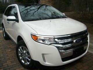 2011 Edge Sel. .  / Navi / Panoroof / Heated / Chromes / Sync / Fogs / Rebuilt photo