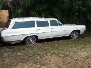 1964 Pontiac Station Wagon Catalina Safari,  Roof Racks,  Surfboard Not Included photo