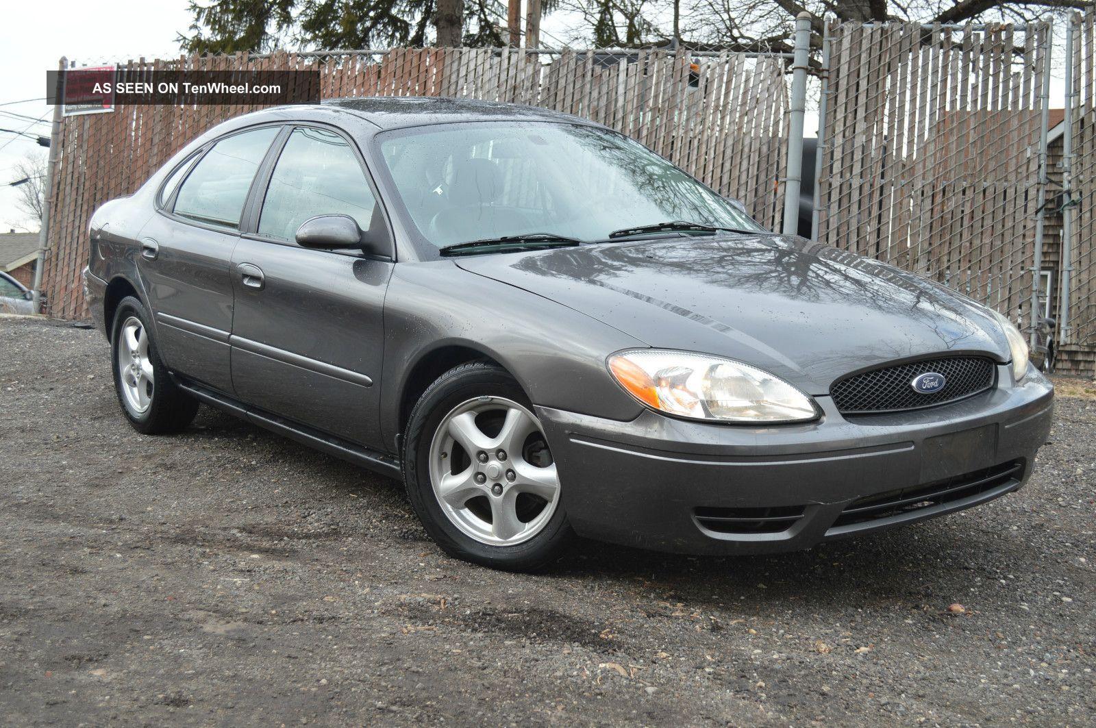2004 gray metallic ford taurus ses v6 3 0l automatic w cd gas saver tenwheel