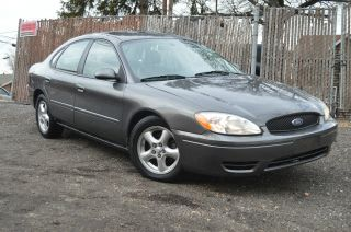 2004 Gray Metallic Ford Taurus Ses V6 3.  0l Automatic W.  & Cd Gas Saver photo