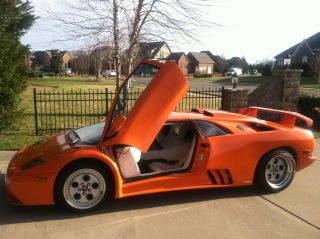 2001 Lamborghini Diablo Orange With White Interior. photo