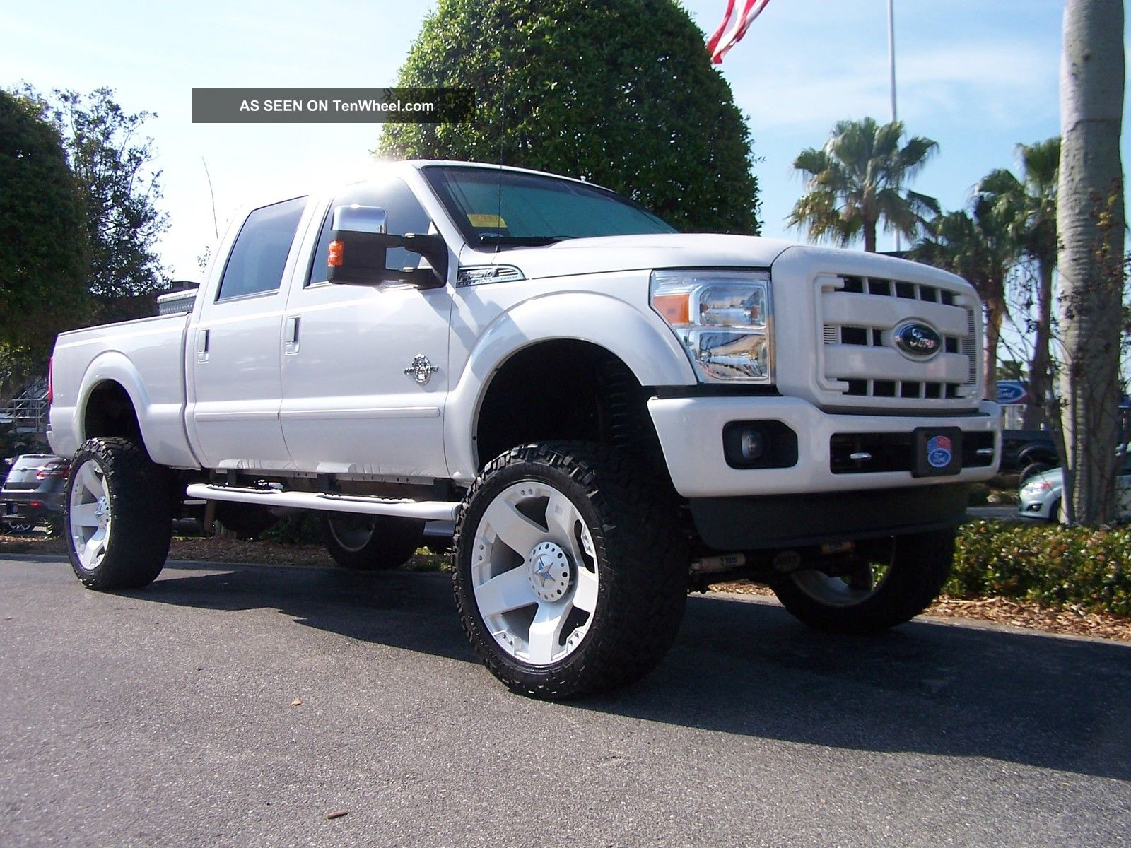 White ford truck with black rims
