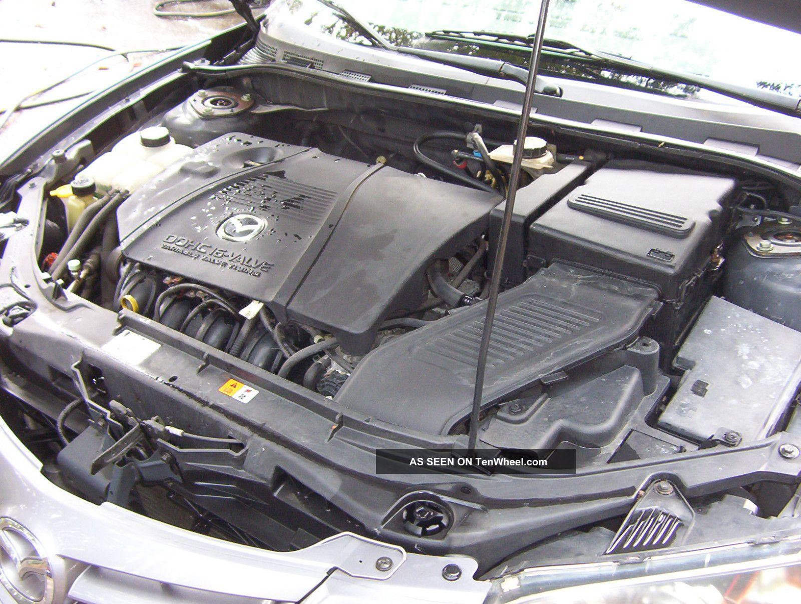 2004 mazda3 gray s sport stick shift inspected needs engine rod 2005 BMW 330Xi 2006 BMW 330Xi