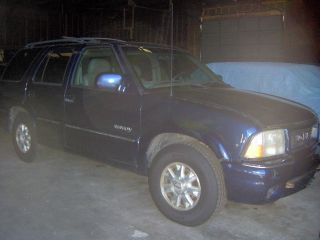 2000 Gmc Envoy. . .  Blown Motor. . .  Body. . .  Clear Title. .  Tires. .  Loaded photo