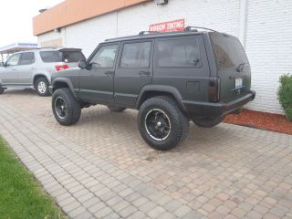 1997 Jeep Cheerokee 4 Inch Lift A / C Flat Black Full Cage 4x4 Nitro Tires Perfect photo