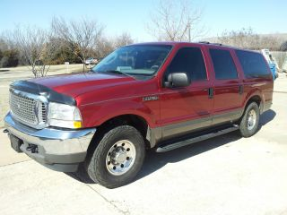 2003 Exursion Xlt,  Red Ext,  Grey Trim / Int,  V - 10 Gas photo
