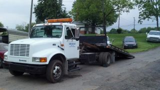 1994 International 4000 Series - Roll Back photo
