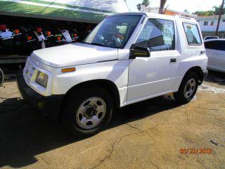1997 Geo Tracker Base Sport Utility 2 - Door 1.  6l Right Side Steering Wheel photo