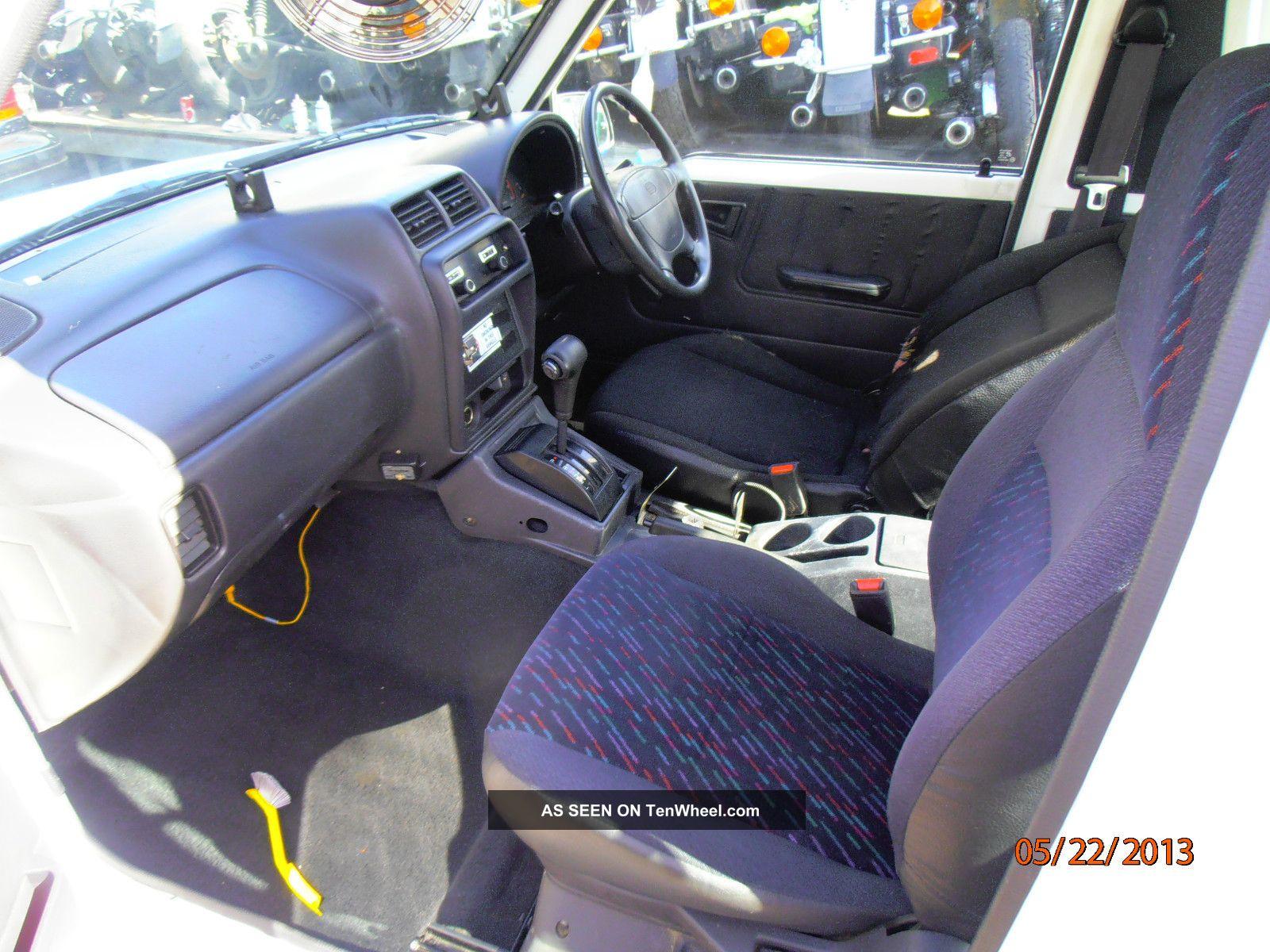 1997 geo tracker base sport utility 2 door 1 6l right side steering wheel. Black Bedroom Furniture Sets. Home Design Ideas