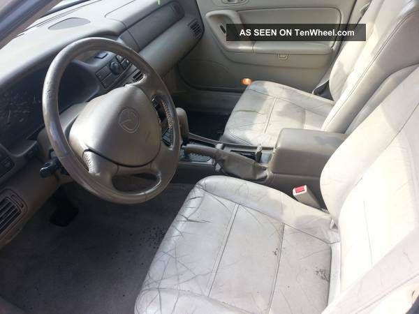 1998 mazda millenia rear door interior repair jm1ta2211w1412880 clear green mazda millenia. Black Bedroom Furniture Sets. Home Design Ideas