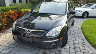 2011 Black Hyundai Elantra Touring W / & Under 5 Year photo