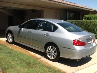 2010 M35; Silver; Like.  Leather; Loaded photo