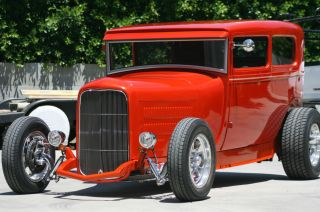 1929 Model A Tudor Hiboy On Pete And Jakes 32 ' Frame.  Metal Work By Marcel photo