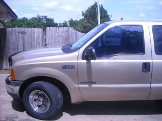 2001 Diesel,  Cowboy Bed,  Chrome Wheels,  Automatic Transmission,  Goose Neck Equip. photo