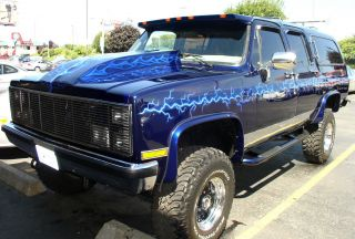 1986 Air Brushed Pearl Blue Suburban Reborn As A Lifted Custom Hot Rod Truck photo