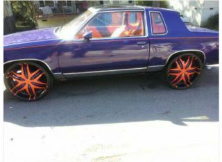 1986 Cutlass Gbody T - Top On 24s Purple And Orange. photo
