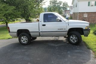 1997 Dodge Ram White 4x4 Michelin Tires photo