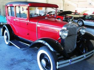 Red And Black Ford Model A 1930 With Tan Interior photo